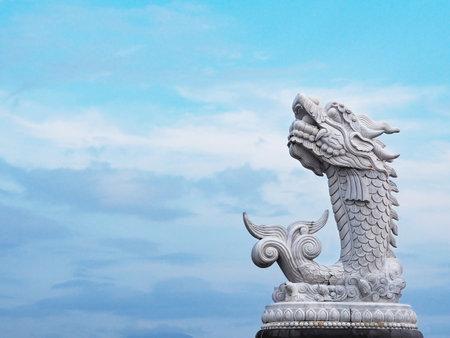 DANANG, VIETNAM - APRIL 03, 2019: Carp Dragon Statue (Ca Chep Hoa Rong) over blue sky background on the river bank in Da Nang city, Vietnam Editorial