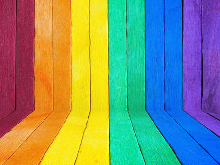 Vintage wood painted in rainbow color. LGBT day concept wooden background.