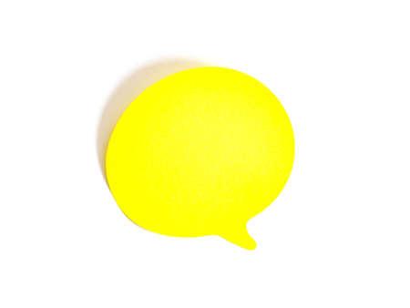 Close up yellow paper bubble speech on white background. Standard-Bild