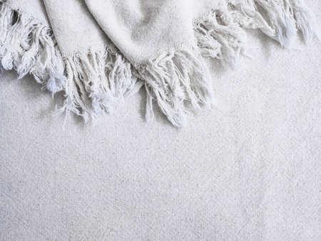 Close up beige cotton fabric texture with fringe edge. Natural vintage textile background..