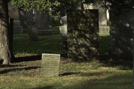 churchyard: New England cemetery with graves dating back to the late 1700s. Stock Photo