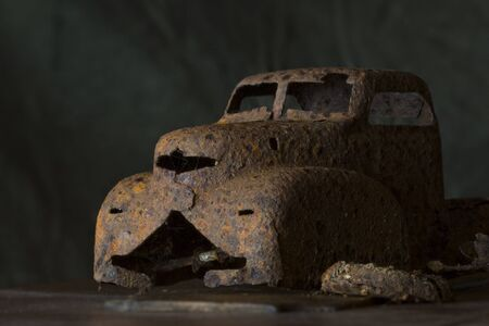 Detail of a rusty child's toy truck unearthed behind our vegetable garden.