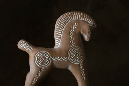 Decorative clay horse, broken and glued, purchased as a souvenir in Greece.