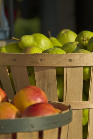 Peaches and pears in baskets at a roadside farm stand in New England.