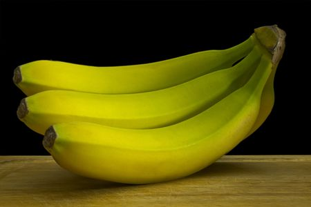 Bunch of green bananas against a black background. Stock Photo - 3007356