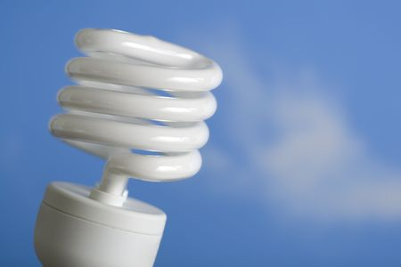 compliant: An energy-saving compact fluorescent light bulb against a blue sky.