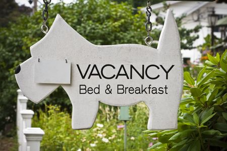 holidays vacancy: Sign in front of New England Bed and Breakfast with flap for no vacancy.