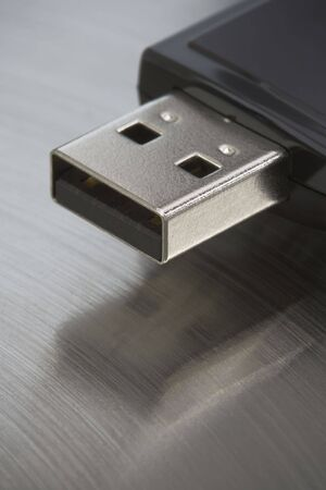 Single USB thumb drive on a stainless steel background. Stock Photo - 3086462