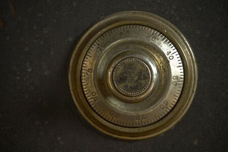 lockbox: Close-up of a combination dial on an antique safe.