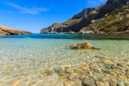 Beautiful bay beach turquoise sea mountains, Cala Figuera on Cap Formentor, Majorca, Spain Reklamní fotografie - 23934369
