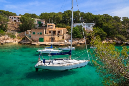 Yacht boats anchored in beautiful bay near small fishing village of Cala Figuera on Majorca island, Spain