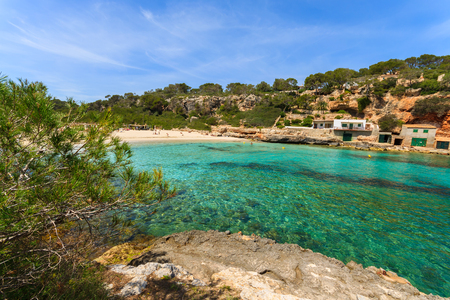 Rocks bay beach azure sea water, Cala Llombards, Majorca island, Spain photo