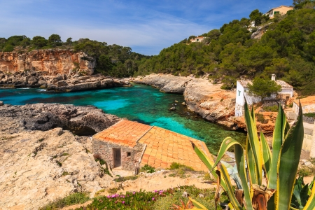 Rocks bay beach traditional house village, Cala SAlmunia, Majorca island, Spain photo