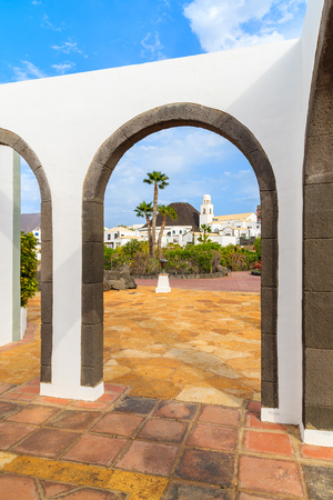 thorough: Canary style building with view of apartments in marina Rubicon thorough arches, Lanzarote, Canary Islands, Spain