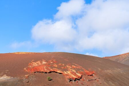 timanfaya: Red volcanic mountain landscape in Timanfaya National Park, Lanzarote, Canary Islands, Spain