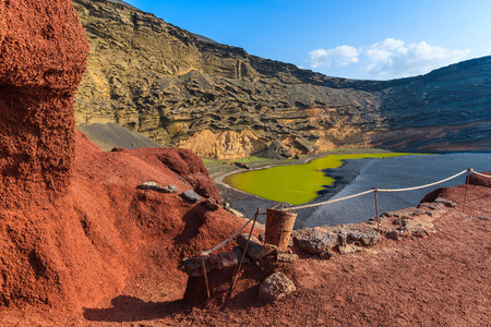 golfo: Red lava rocks and green water of Lago Verde, El Golfo, Lanzarote, Canary Islands, Spain