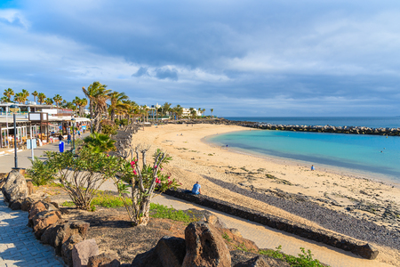 Flamingo beach in Playa Blanca holiday village on coast of Lanzarote island, Spain Stock Photo