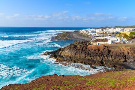 island: View of El Golfo village and blue ocean on coast of Lanzarote island, Spain Stock Photo