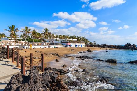 carmen: Sandy tropical beach in Puerto del Carmen seaside town, Lanzarote, Canary Islands, Spain