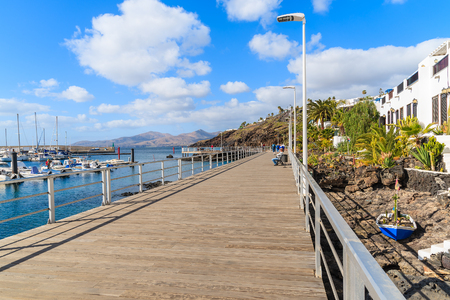 Promenade along ocean in Puerto del Carmen holiday resort town, Lanzarote, Canary Islands, Spain