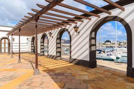 thorough: Canary style building with view of marina Rubicon thorough arches, Lanzarote, Canary Islands, Spain