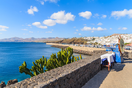 View of coast from promenade on Lanzarote island in Puerto del Carmen town, Spain