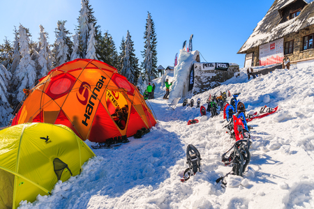 lear: GORCE MOUNTAINS, POLAND - FEB 14, 2015: colorful tents of winter camp located near Turbacz shelter. Every February tourists lear