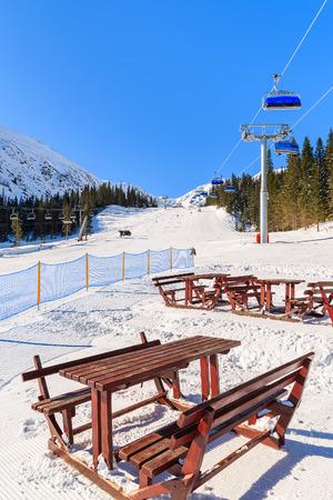 Tables in restaurant on ski slope in Rohace winter resort, Tatra Mountains, Slovakia Stock Photo