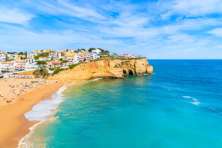 View of beach with in Carvoeiro town with colorful houses on coast of Portugal