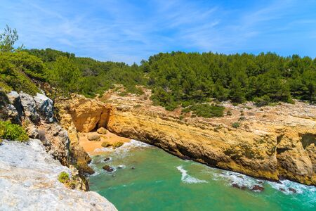 secluded: Secluded beach in bay with rocky cliffs on coast of Algarve region, Portugal