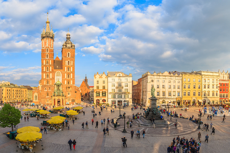 mickiewicz: KRAKOW, POLAND - APR 29, 2015: Mariacki cathedral on main market square of Krakow city. More than 10 Million tourists visit the Editorial
