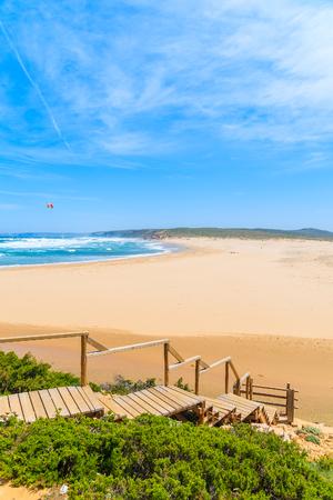 Wooden walkway to idyllic sandy Praia do Bordeira beach, Algarve region, Portugal