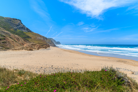 A view of sandy Castelejo beach, famous place for surfing, Algarve region, Portugal Stock Photo