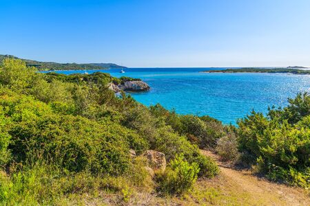 Coastal path and view of beautiful sea lagoon with turquoise water near Grande Sperone bay, Corsica island, France