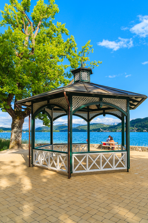 Summer house in park on shore of Worthersee lake on beautiful summer day, Austria Stock Photo