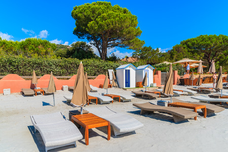 Sunbeds on Palombaggia beach on sunny summer day, Corsica island, France Stock Photo