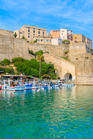 Typical old fishing boats in Calvi port on sunny summer day, Corsica island, France