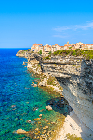 A view of Bonifacio old town built on high cliff above the sea, Corsica island, France