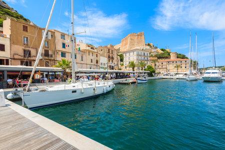 BONIFACIO PORT, CORSICA ISLAND - JUN 23, 2015: sailing boats in Bonifacio port on sunny summer day, Corsica island, France.