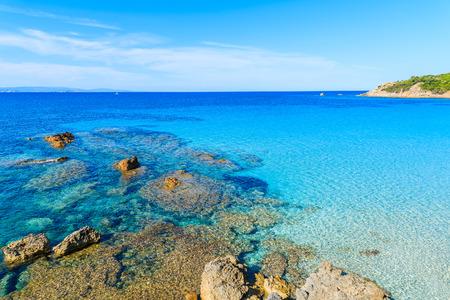 secluded: Rocks in crystal clear azure sea water in Grande Sperone bay, Corsica island, France