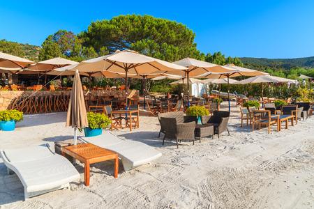 Sunbeds on sandy Palombaggia beach, Corsica island, France