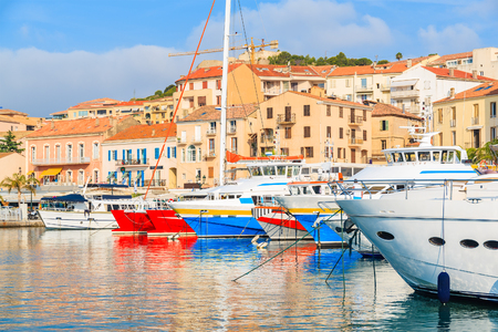 A view of Calvi port with colorful houses and boats, Corsica island, France