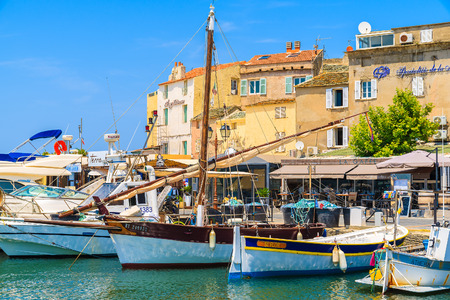 SAINT FLORENT, CORSICA ISLAND - JUN 30, 2015: fishing boats in small port of Saint Florent, Corsica island, France.