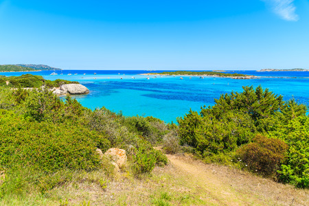 Path along coast with turquoise sea water near Grande Sperone beach, Corsica island, France