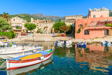 ERBALUNGA, CORSICA ISLAND - JUL 4, 2015: colorful fishing boat in Erbalunga port on Cap Corse. This small village is known also