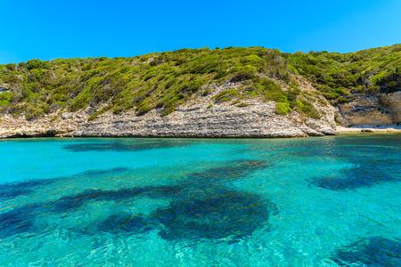 Crystal clear sea water in secluded bay near Bonifacio town, Corsica island, France