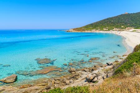 Azure sea water on Bodri beach near Llle Rousse, Corsica island, France