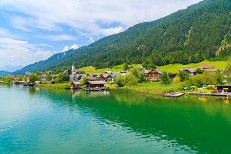 Beautiful green water Weissensee alpine lake in summer landscape of Alps Mountains, Austria