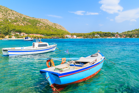 Greek fishing boats on turquoise sea water in Posidonio bay, Samos island, Greece Stock Photo