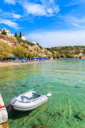Dinghy boat on turquoise sea water at Pythagorion beach, Samos island, Greece Stock Photo